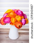 Flowers In A Vase On Wooden...