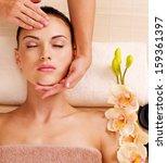 masseur doing massage the head... | Shutterstock . vector #159361397