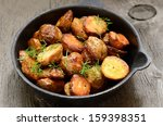 roasted potato in a frying pan... | Shutterstock . vector #159398351