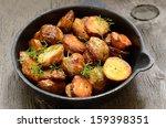 roasted potato in a frying pan... | Shutterstock . vector #159398351