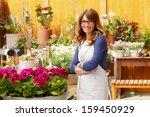 smiling mature woman florist... | Shutterstock . vector #159450929