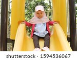 Little Cute Girl Playing On Th...