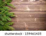 Spruce Twigs On A Wooden...