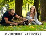 couple playing with dog | Shutterstock . vector #159464519