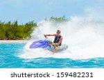 Man On Jet Ski Having Fun In...