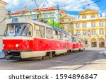Typical old retro vintage tram on tracks near tram stop in the streets of Prague city near Sternberg palace in Lesser Town (Mala Strana) district, Bohemia, Czech Republic. Public transport concept.