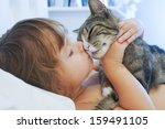 Stock photo child is kissing a cat 159491105