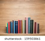 old books on a wooden shelf.  | Shutterstock . vector #159503861