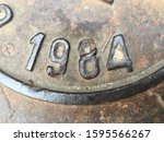 The year 1984 on a manhole cover made of iron and produced that year