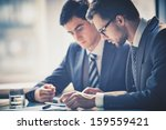 image of two young businessmen... | Shutterstock . vector #159559421
