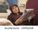 Small photo of Young woman read newspaper in passenger roomette