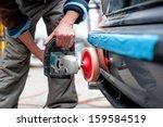 professional mechanic using a... | Shutterstock . vector #159584519