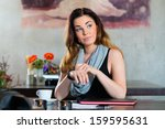 young woman in a cafe or... | Shutterstock . vector #159595631