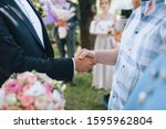 Male handshake close up. Wedding ceremony. Consent, transaction, contract. Conference and meeting. A business meeting. Photography, concept. - stock photo