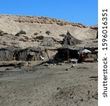 Small photo of Unorganized camping on the arid rocky shores of Punta de Las Gaviotas protected area on Costa Adeje, South West Tenerife, Spain