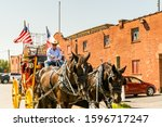 Small photo of Dallas, USA, Sep 17, 2017, Horse carriage with two horses with USA national flag in the Fort Worth Stockyards, a historic district that is located in Fort Worth, Texas