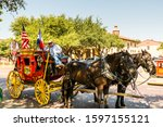 Small photo of Dallas, USA, Sep 17, 2017, Horse carriage with two horses with USA national flag in the Fort Worth Stockyards, a historic district that is located in Fort Worth, Texas, USA.