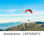 Bright Paraglider Floating In...