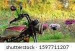 Old Rusty Motorcycle In Garden...