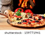 pizza lifting slice with... | Shutterstock . vector #159771941