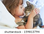 Stock photo child is kissing a cat 159813794