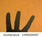 Three Fingers Shadow On Orange...