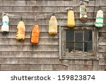 Colorful Buoys On The Old Hous...