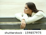 Young Lonely Woman On Bench In...