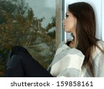 lonely sad woman looking... | Shutterstock . vector #159858161