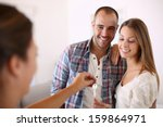 Cheerful Couple Getting Keys Of ...