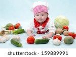 baby cook girl wearing chef hat ...
