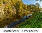 Early Autumn By A River With...