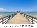 Midday At Naples Pier On Beach...