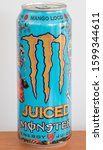 Small photo of Pruszcz Gdanski, Poland - December 11, 2019: Monster Juiced Mango Loco energy drink.