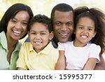 family outdoors smiling | Shutterstock . vector #15995377