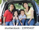 family sitting in back of van... | Shutterstock . vector #15995437