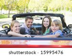 family in convertible car... | Shutterstock . vector #15995476
