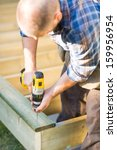 carpenter using cordless drill... | Shutterstock . vector #159956954