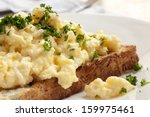 Scrambled Eggs On Toasted...