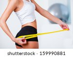 sports woman measuring her... | Shutterstock . vector #159990881