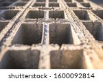Small photo of Concrete block bricks in stack for wall construction. Concrete block, cinder blocks, breeze blocks, hollow blocks, Besser blocks or Besser bricks wall background, brick texture.