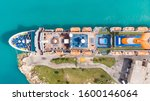 Small photo of City in Grand Bahama, The Bahamas - December 27, 2019: Aerial View on Grand Cruise Ship in Freeport in Grand Bahama. Drone view on Freeport landscape. Cruise Ship staying in port dock.