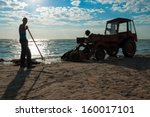 Tractor Cleaning Seaweed On Se...
