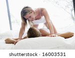 couple lying in bed being... | Shutterstock . vector #16003531