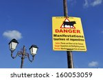 Sign warning people for danger at the streets when there are equestrian and bullfighting events in Sainte Marie de la Mer in France - stock photo