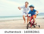 father and son learning to ride ... | Shutterstock . vector #160082861