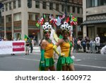 Brazilian soccer fans on pride parade on fifth avenue of borough of Manhattan of city of New York - stock photo