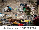 Small photo of Dehradun, Uttarakhand, India - February 13, 2018 Poor homeless children living on street during winter with their families near Parade Ground in Dehradun.