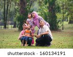 malay family having fun in the ... | Shutterstock . vector #160134191