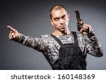 soldier with guns against dark... | Shutterstock . vector #160148369